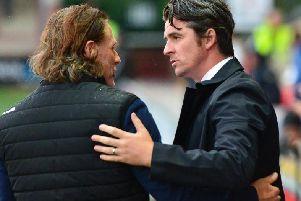 Gareth Ainsworth and Joey Barton greet each other