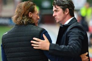 Gareth Ainsworth and Joey Barton embrace