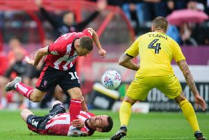 Lincoln City's Jack Payne and Harry Toffolo (3) vie for possession with Fleetwood Town's Peter Clarke