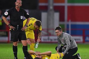 Wes Burns gets treatment on the pitch