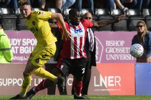 Harry Souttar played at Lincoln City before heading off on international duty