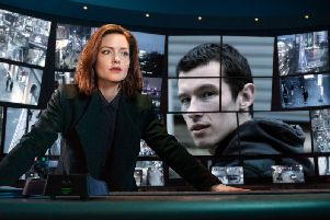 DI Carey (Holliday Grainger) keeps an eye on Shaun Emery (Callum Turner) in the new BBC thriller The Capture
