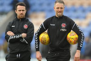 Fleetwood Town coach Clint Hill (right) won't be pulling on his boots again