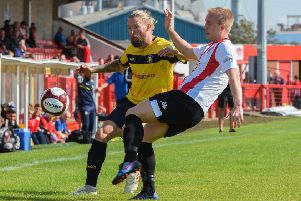 Kingsley James in the thick of the action for Gainsborough Trinity at Witton Albion. (PHOTO BY: John Rudkin)