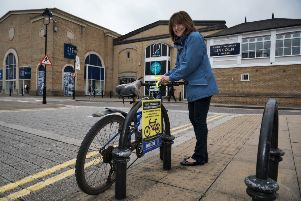 Sally Picker, Crime Reduction Tactical Advisor for Lincolnshire Police tagging a bike