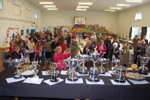 An array of trophies and large crowds at a previous Sturton and Stow Show.