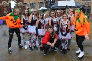 The dance crew at The Studio Gainsborough pose for the camera with a couple of fancy-dress pumpkins on roller skates.