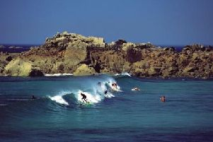 Surfing in Guernsey's Vazon Bay