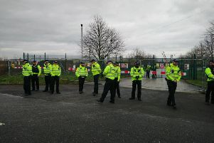 Police at a fracking site