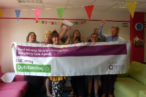 Staff celebrate the outstanding rating awarded to Mencap's domiciliary care service in Lincolnshire.