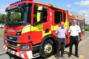 Chief Fire Officer Les Britzman and Coun Nick Worth with the first of the new fire appliances.