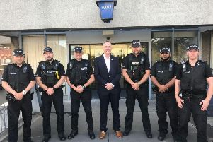 Clive Grunshaw, Lancashires Police and Crime Commissioner (PCC), with police officers outside Chorley Police Station