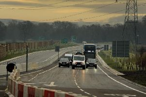 A highways van leads the first vehicles on the new Penwortham Bypass.