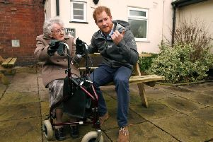 Prince Harry chats with Winifred Hodson at St Michael's when he visited following the Christmas floods of 2015.