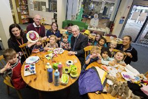 UCLan vice chancellor Prof Mike Thomas with children form the pre-school centre at the In The City shop