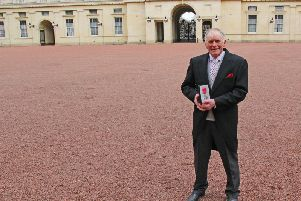 Bernard Rimmer with his MBE outside Buckingham Palace