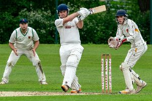 Garstang CC's Mark Walling hits a boundary against Chorley                  Picture: Tim Gilbert/Preston Photographic Society