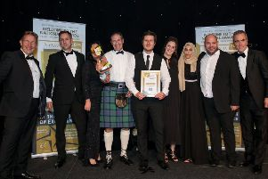 WINNERS: YES Energy Solutions is presented with Project Management Company of the Year award. Photo by Jason Mitchell