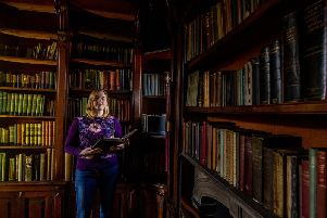 Angela Clare, Collections Manager for Calderdale Museums, in the Tower Library at Shibden Hall, Halifax
