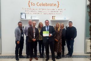 The Institute presents a plaque to some of the Commercial & HNW team members at Cova Insurance
