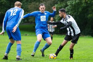 Actions from the game, Hollins Holme v FC Panda. Pictured is Richard Laycock and Tariq Pervez