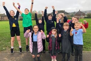Garden Grant: Pupils at St Michaels and All Angels CE Primary School celebrate the �1,000 donation.