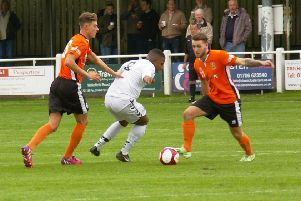 stalemate: Brighouse Town's Luke Parkin tries to get an attack going in Saturday's clash against Mossley.