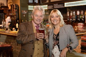 Malandra Burrows (Kathy Glover) and Frazer Hines (Joe Sugden) celebrate Emmerdale's 45th anniversary.  Picture: Bruce Rollinson