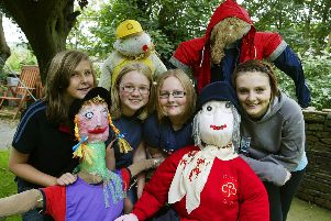 2010: From the left, Ellie Houlihan, 13, Rebecca Veall, 12, and Abigail Fraser, 13, from first Sowerby Bridge Guides, and Naomi Rogers, 17, from Sowerby Bridge Senior Section, with Scarecrows made Sowerby Division Guides, Brownies and Rainbows for the Norland Scarecrow Festival