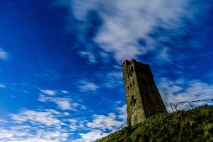 Date: 8th October 2017.'Picture James Hardisty.'Possible Picture Post.....A Draconid meteors pasing over head in night's sky at Castle Hill, Huddersfield, West Yorkshire, just visible through the cloud base last night (Sunday).