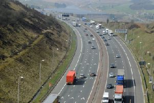 M62 incident: Motorway re-opens after woman talked down from Scammonden Bridge