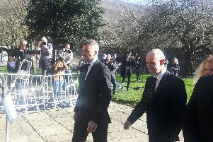 David Beckham and Gary Neville arrive at the funeral of Eric Harrison.