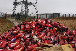 The huge pile of fire extinguishers dumped on Windy Hill