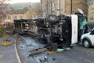 The overturned lorry.