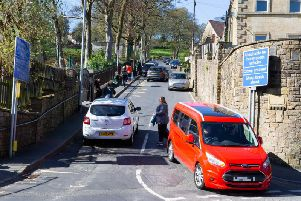 Traffic on Butterworth Lane in Triangle, close to Triangle Primary School
