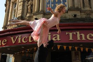 The stars of Dirty Dancing perform the iconic lift outside the Victoria Theatre in Halifax.
