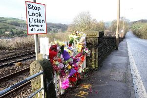 Floral tributes at the crossing where Milena Gagic was killed