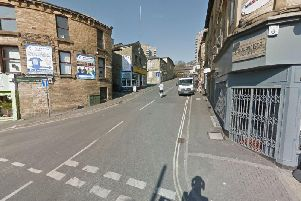 Five men have been arrested after armed police found a rifle in Sowerby Bridge, Halifax.