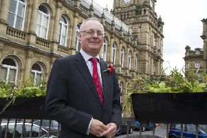 Concillor Tim Swift outside Halifax Town Hall.