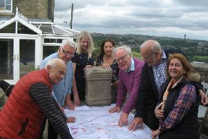 Members of the Neighbourhood Plan Committee discussing the altar and proposed stone replica