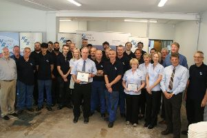 Staff from Halifax Rack and Screw being presented with their award