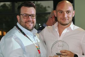 Success: Adam Down, chief executive of crowd control specialist Foam Hand, presents the award to Rosehill Security's Dalton Marshall.