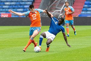 Liam Nolan in action for Halifax during their 1-0 pre-season win at Oldham. Photo: Ian Charles