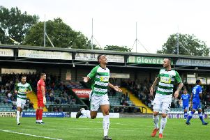 YEOVIL, ENGLAND - AUGUST 06: Courtney Duffus of Yeovil Town(C) celebrates after scoring his sides first goal during the Vanarama National League match between Yeovil Town and Eastleigh FC at Huish Park on August 06, 2019 in Yeovil, England. (Photo by Harry Trump/Getty Images)