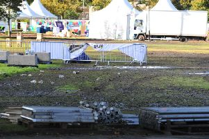 The clean up operation begins in the Fan Zone. Picture: Gerard Binks