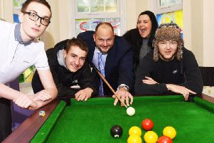 James Cliffe, group manager, with young people in No Wrong Door.