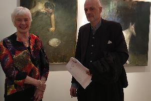 Harrogate Open competition - First prize winner Neil Bolton standing in front of Untitled with Judith Thomas, chair of the Friends of the Mercer Gallery.