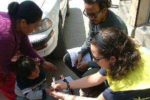 Sarah Bosomworth helping with a polio vaccination campaign in Kathmandu. Below, charity swimmer Sarah Bosomworth (s)