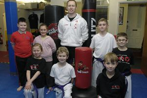 Chris Jones and a mixed martial arts class with some of the new equipment.  (130114M2a)