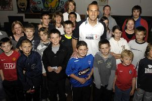 Mark Schwarzer with young carers at Starbeck Youth and Community Centre.